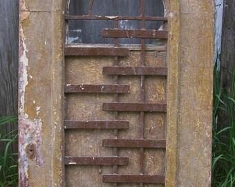 antique art deco iron window,arched transom window panel,old rustic architectural window,mediterranean door header,wall art,garden art