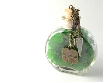"One Pound of Rhode Island Green Sea Glass, with a ""Dreaming of the Sea"" Charm, an Antique Brass Key Charm and a Piece of Purple Sea Glass"