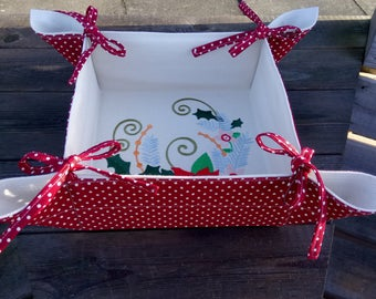 Fabric storage basket featuring a Christmas Poinsettia design. Retro or vintage styling.