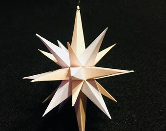 Four inch handmade paper Light Pink and White Moravian Star (Bethlehem Star) used as decoration, ornaments or art.