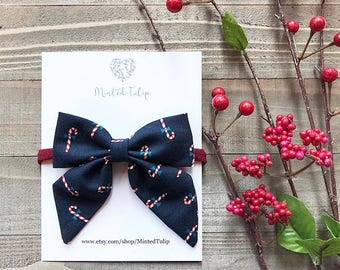 CLEARANCE Christmas Navy Blue Candy Cane Print Small or Large Sailer Bow on Nylon Headband or Hair Clip Baby Toddler Kids