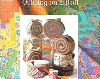 Strip Happy: Quilting on a Roll by Suzanne McNeill