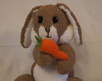 Hand knitted cute as a button bunny rabbit, designed by Alan Dart, knitted by Liz