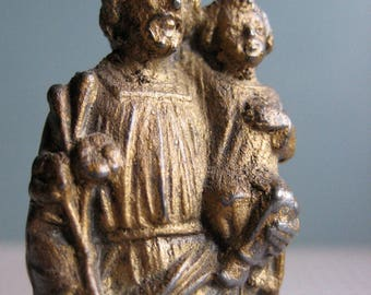A small vintage French statue of Joseph and Jesus, painted metal statue