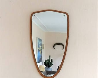 Large mid-century Danish teak wall mirror in a shield / modernist shape. Made in Denmark. Modern Danish furniture.