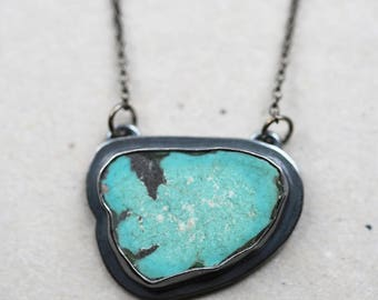 american mined turquoise necklace. freeform slab turquoise. polished oxidized sterling silver jewelry