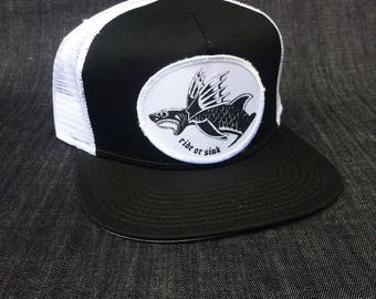 RideOrSink, Fly Fish patch design 0n a baseball cap.