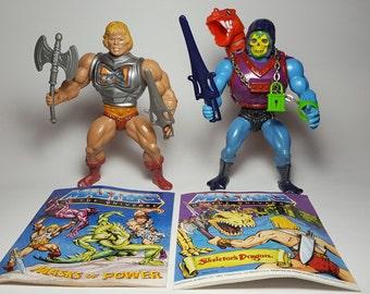 Vintage MOTU 1983 Battle Armor He-Man and 1984 Dragon Blaster Skeletor