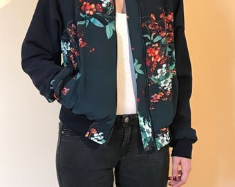 Woman with floral print bomber jacket