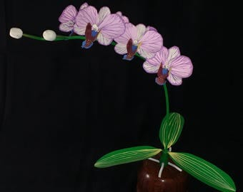 "Orchid, Phalaenopsis, Wood flower, atop a painted copper stem leaf, in a highly polished Paduak vase. 15"" high, 15""  wide, 9"""