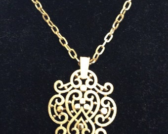 """Vintage TrafariThis is 18"""" Gold Tone Pendant Necklace"""