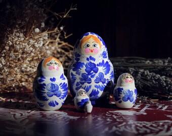 Russian nesting doll matryoshka blonde redhead five pieces of blue and white wood style folk Russian Slavic folk retro Bohemian Gypsy boho