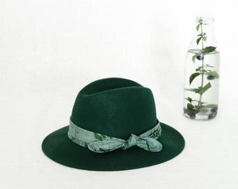 Green fedora hat decorated with a batik scarf