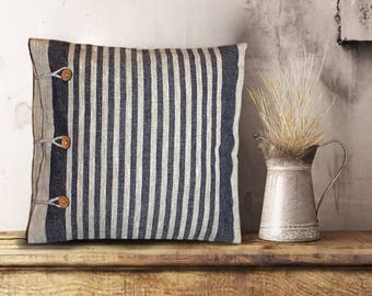Linen decorative pillow made of ecological material. Striped fabric of untreated flax, wooden buttons, minimalism