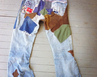 Vintage Levi Jeans, Patched Levis, Big E Levi's, Bell Bottom jeans, Distressed holes, Destroyed denim, 1970s Levi Jeans, old Patchwork jeans