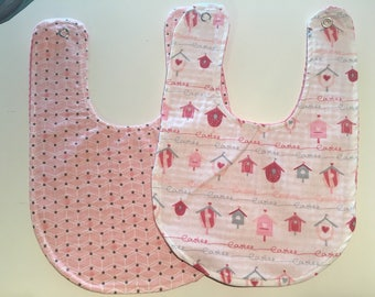 Set of two bibs in shades of pink.