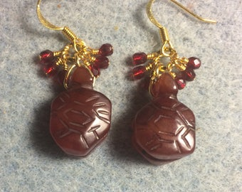 Carved dark red brown agate gemstone turtle bead earrings adorned with tiny dangling dark red Czech glass beads.