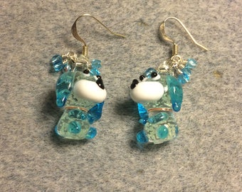 Turquoise and white glow in the dark lampwork puppy dog charm earrings adorned with small dangling turquoise Czech glass beads.