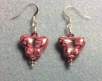 Pink and black ceramic butterfly dangle earrings adorned with pink Czech glass beads.