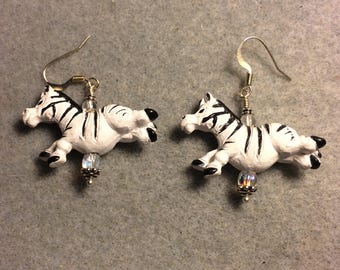 White and black striped ceramic silly jumping zebra bead dangle earrings adorned with clear Czech glass beads.
