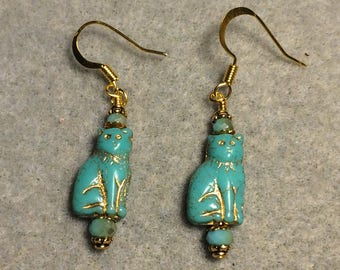 Small opaque turquoise Czech glass cat bead dangle earrings adorned with turquoise Chinese crystal beads.