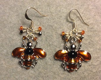 Orange and black enamel honeybee charm earrings adorned with tiny dangling orange and black Chinese crystal beads.