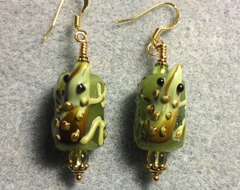 Olive green and brown lampwork lizard bead earrings adorned with olive green Czech glass beads.