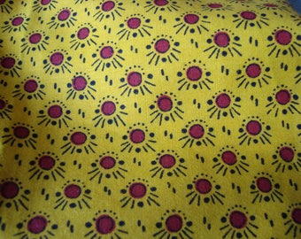 Cotton fabric with red polka dots, yellow background