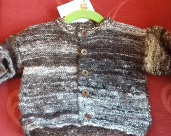 Hand knitted cardigan, knitted with home spun wool to fit a child aged 6-12 months old