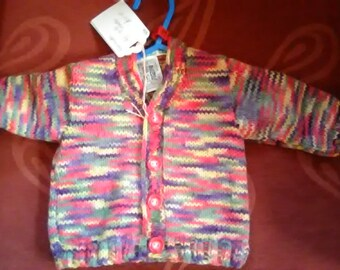 Hand knitted cardigan to fit a child aged 0-6 months old