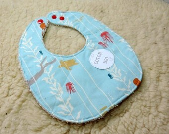 boy in organic cotton baby bib