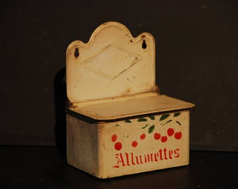 French vintage tin box for matches with pretty painted decor on front. This box hangs on a wall or can sit on your kitchen counter.
