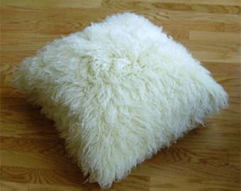 """Natural 18"""" x 18"""" flokati shag pillow. 100% wool. Machine washable. Comes complete with insert."""