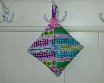 Decorated with flowers and dots a scented sachet scented with Lavender