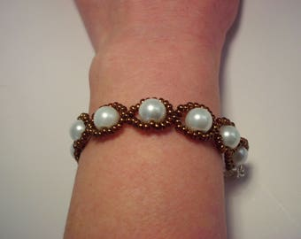 Bracelet white pearls surrounded with bronze metallic seed beads