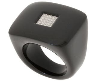 Black square ring and diamonds.