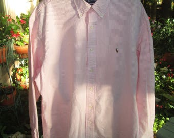 Vintage Ralph Lauren pink and white striped button down long sleeve shirt w/Polo logo on front pocket.Yarmouth 100% cotton Size 16/35.