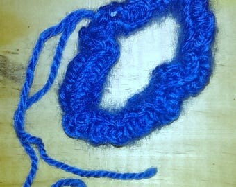 scrunchies made with a dark blue knitting wool