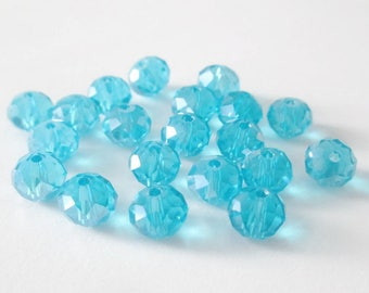 20 beads faceted blue iridescent glass 6x8mm