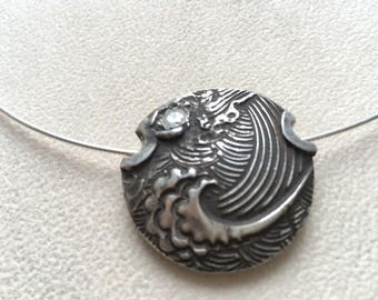 "Sterling silver ""fish,ocean, compass and star"" reversible lentil bead with CZ."