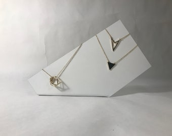 White metal necklace display