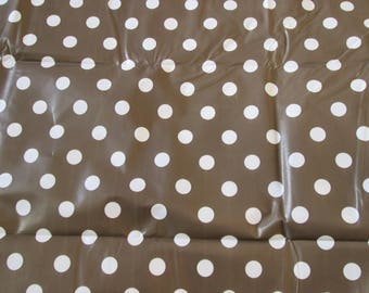 Canvas coated or waxed, brown color with white dots