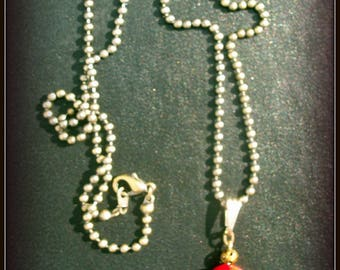 Natural coral with matching bronze chain pendant