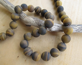 Set of 5 round beads 12 mm natural frosted Tiger eye stone.