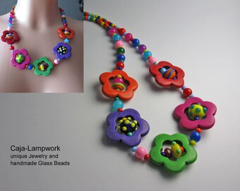 Necklace made of colorful glass beads and flower beads