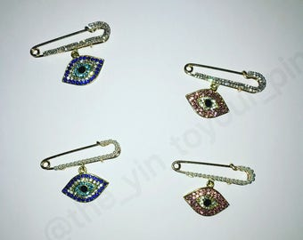 Evil eye pins.  Evil eye stroller pin. Evil eye onsie pin.  Against evil eye.