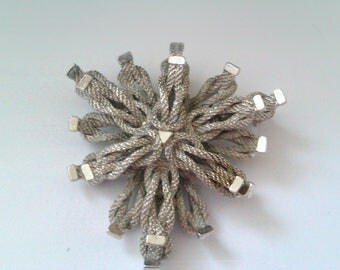vintage deco style silver coloued knotted rope effect brooch