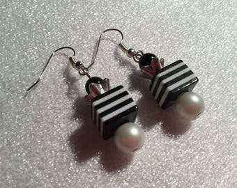 Earrings with black beads and white round and square and metal flower bead