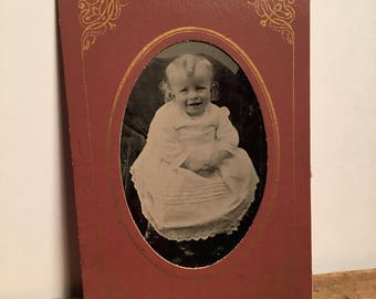 Quality Tintype of a Little Kid with a Precious Smile, 19th Century Antique Photo in Original Paper Frame Sleeve