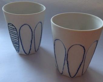 Set of two ceramic coffee/tea/espresso cups - white porcelain with blue decoration. Handmade.